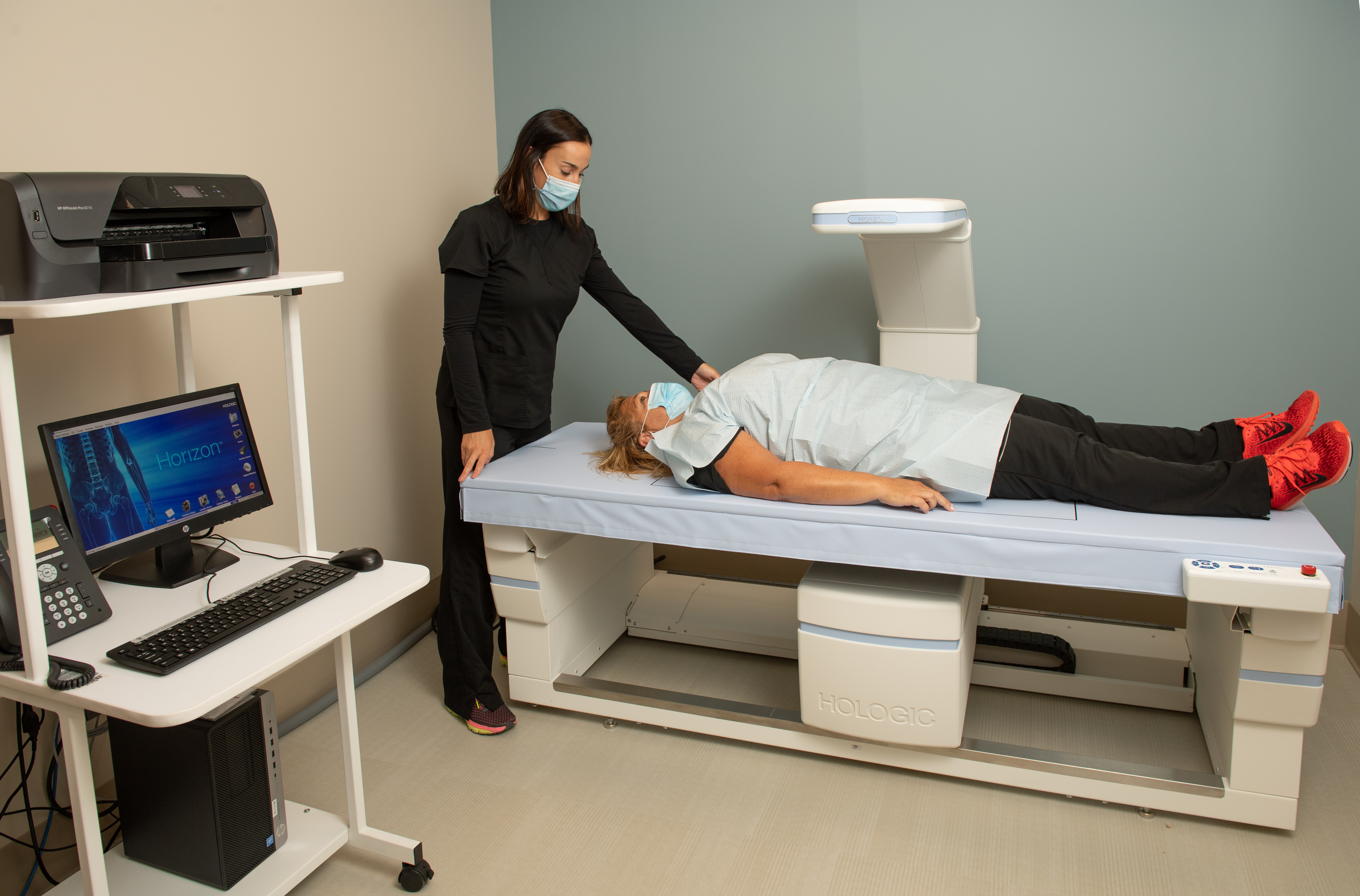 provider assisting patient with dexa imaging