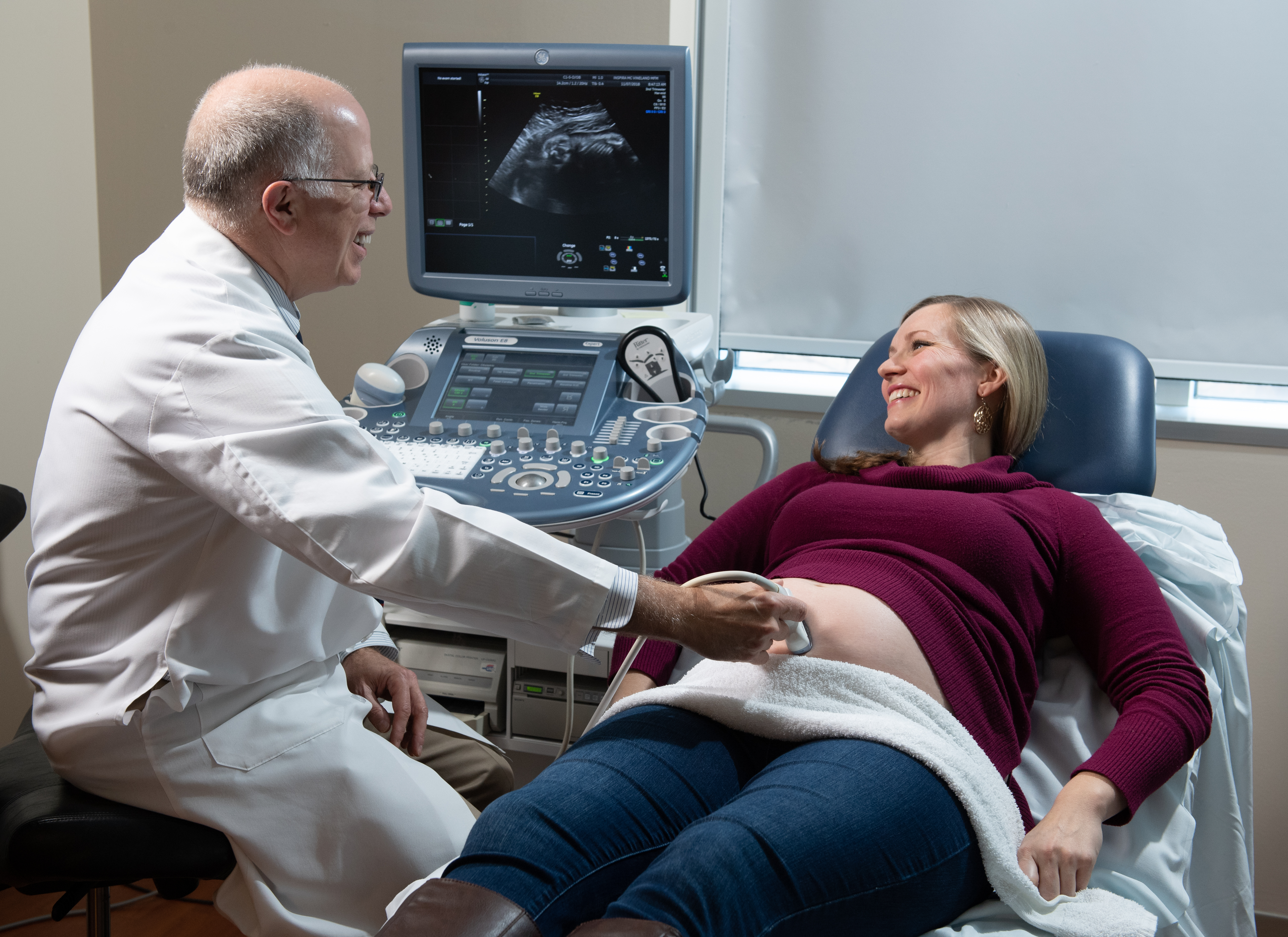 Prenatal exam Doctor with patient doing an ultrasound