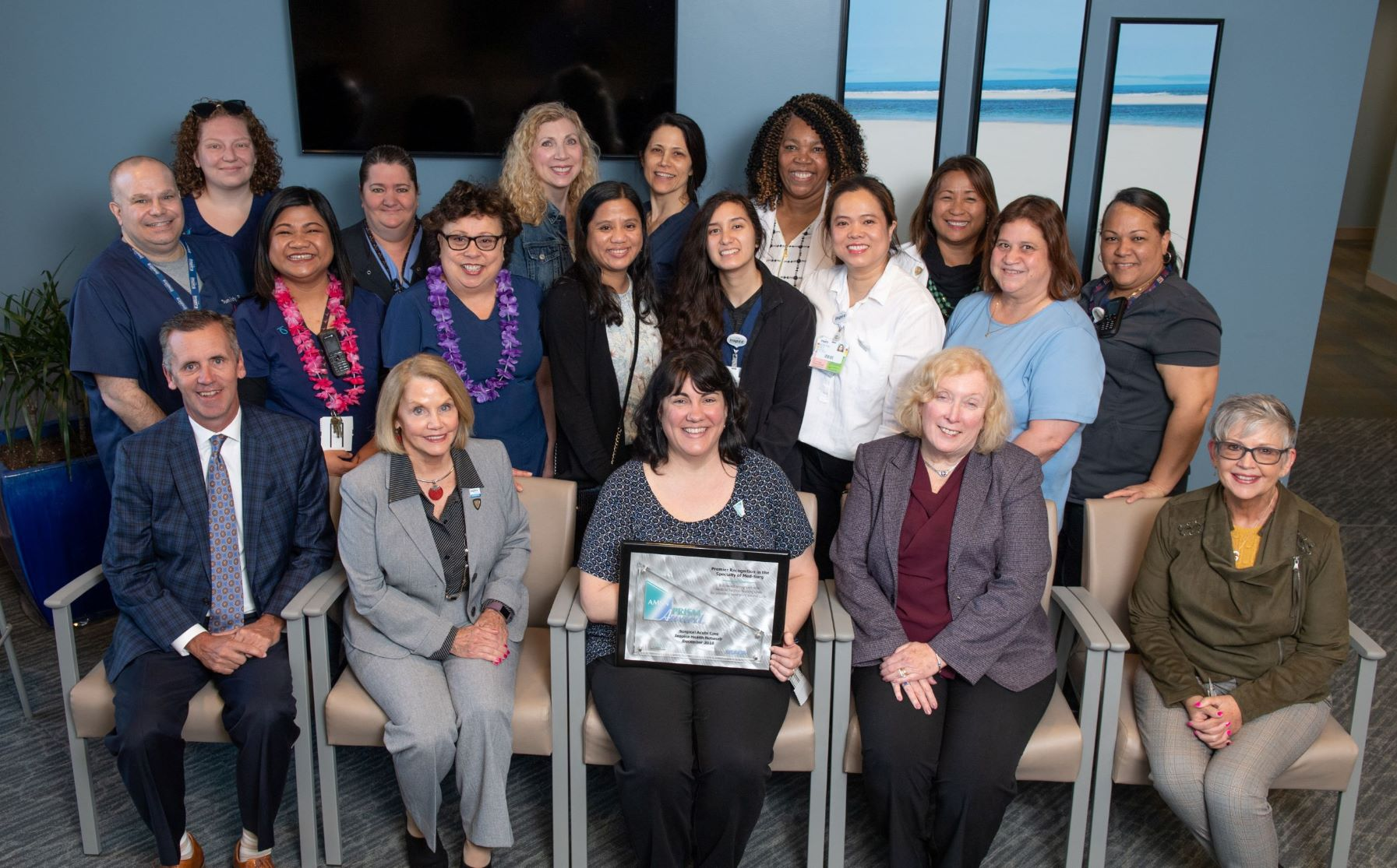 nspira Vineland's Surgical Acute Care Unit receiving the PRISM Award