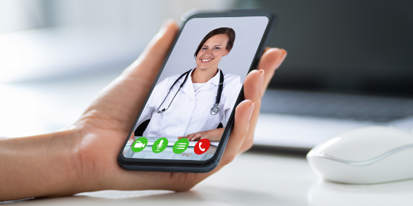 virtual visit on smartphone with female doctor