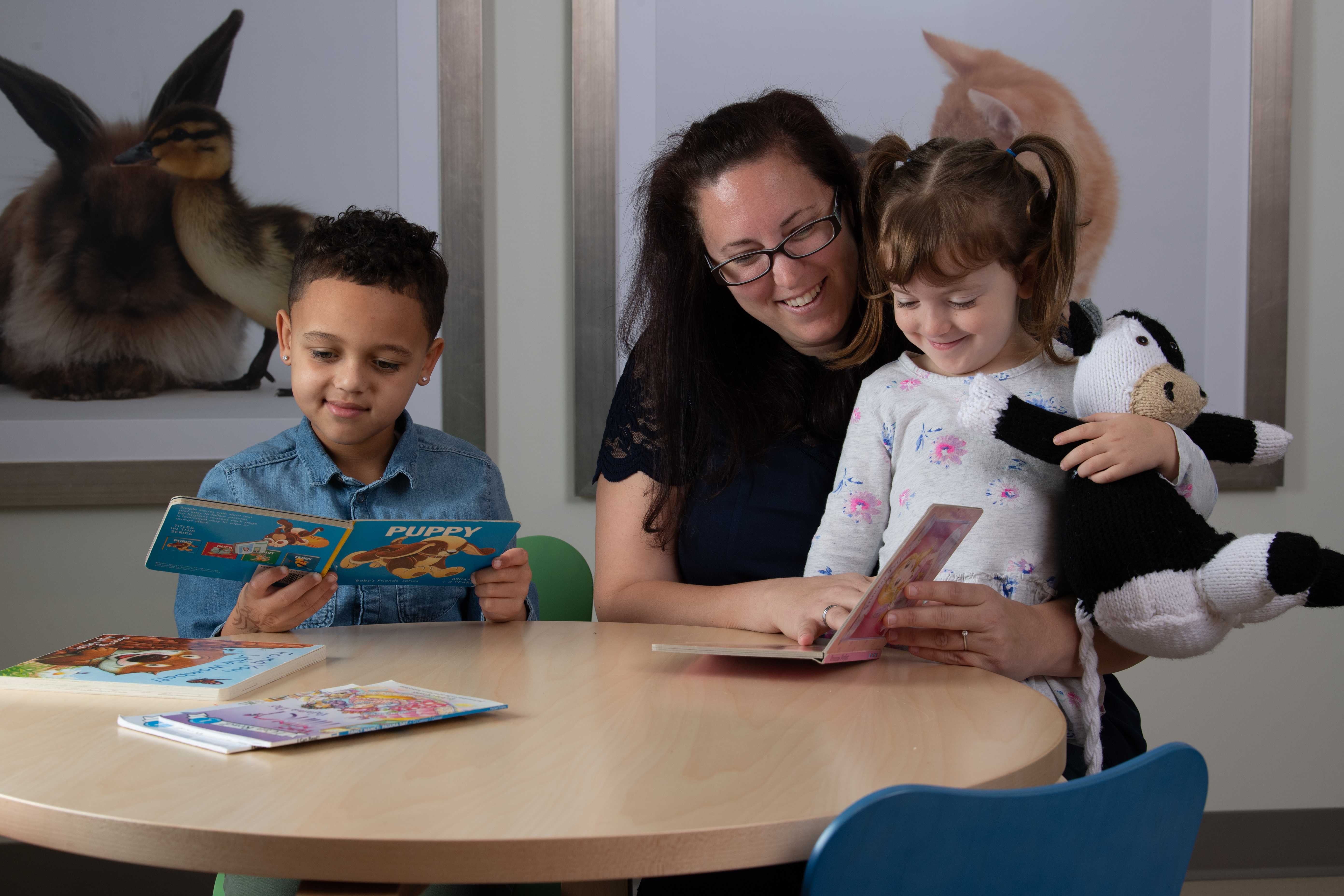 woman and two children playing while in hospital waiting room