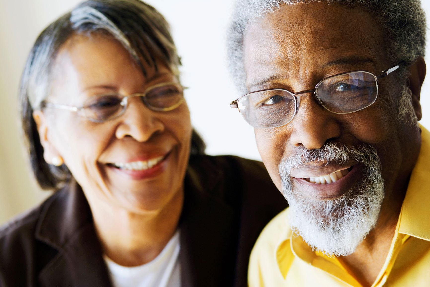 Older smiling man and woman