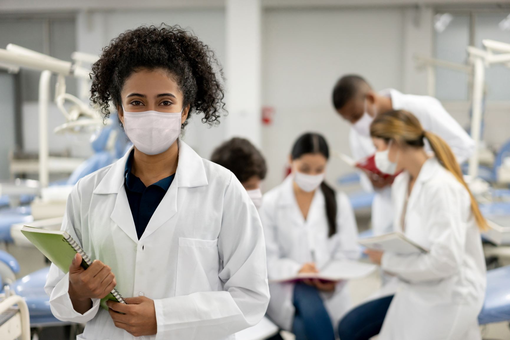 Medical students in masks and lab coats