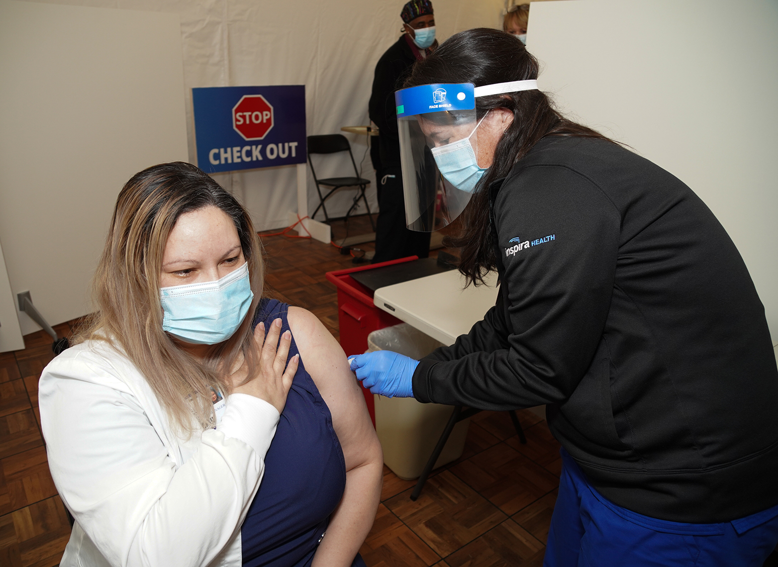 Cathy Vasquez receiving the COVID-19 vaccine