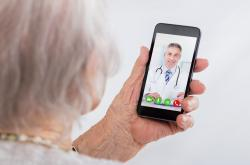 older woman facetiming with a male physician