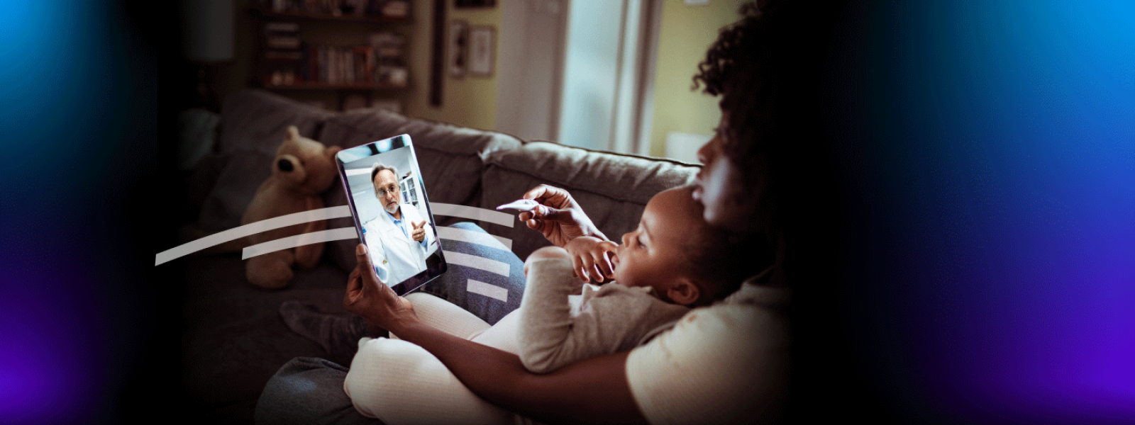 Woman with toddler attending virtual appointment