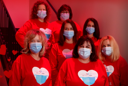 Group of people wearing red cardiac partners shirts while wearing face masks