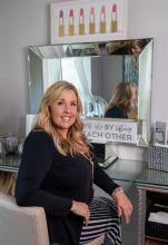 Karen McGowen sitting at a vanity