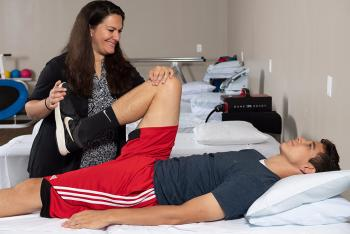 An Inspira nurse performing physical therapy