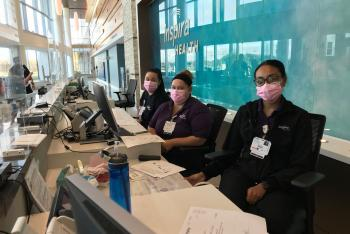 Patient Registration, guest services wearing pink masks