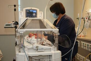 Deborah f sager neonatal intensive care unit inspira health nemours dupont pediatrics donation, nurse assisting to premature baby in bed