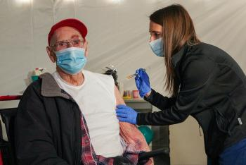 WWII Veteran receiving COVID-19 Vaccine